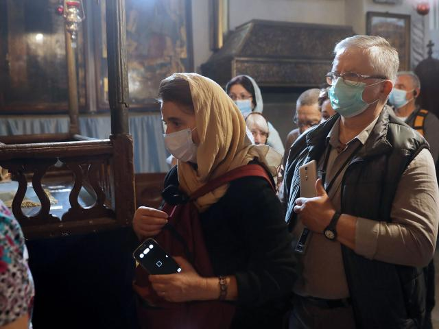 People visit the Church of the Nativity in Bethlehem Thurs, March 5, 2020. Palestinian authorities said the Church of the Nativity in Bethlehem, built atop the spot where Christians believe Jesus was born, will close indefinitely due to virus concerns
