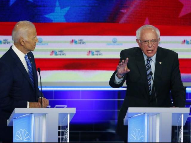 Democratic presidential candidate Sen. Bernie Sanders, (I-Vt.), speaks during the Democratic primary debate as former Vice President Joe Bide watches on Thursday, June 29, 2019, in Miami, Fla. (AP Photo/Wilfredo Lee)