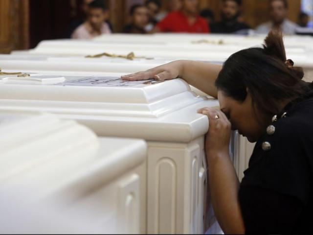 A relative of a slain Christian grieves during funeral service at Church of Great Martyr Prince Tadros, in Minya, Egypt, Saturday, Nov. 3, 2018. AP Photo.