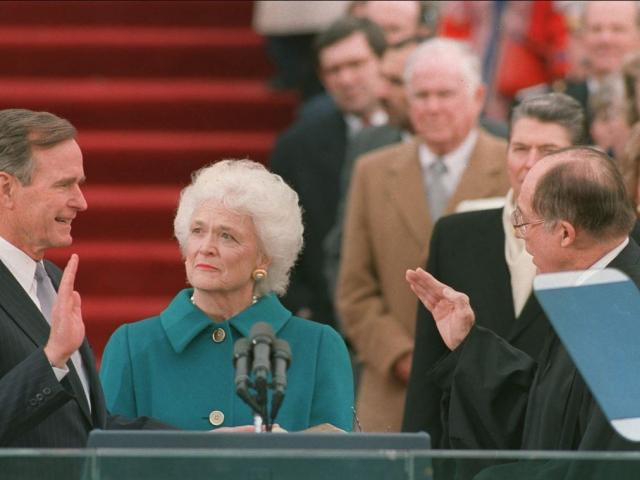 President Bush is sworn in as the 41st president of the United States by Chief Justice William Rehnquist. AP photo.