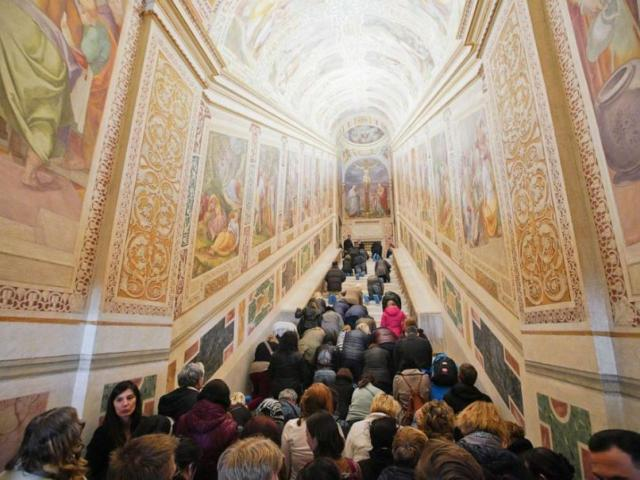 Believers kneel on the newly restored marble steps of the Holy Stairs after they are unveiled in Rome. (Image credit: Andrew Medichini/AP)