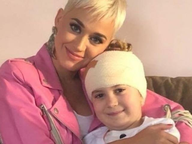 The pop superstar found out that one of her biggest fans, Grace Moores, couldn't make a concert in Adelaide, Australia because she had to have brain surgery to remove a tumor.