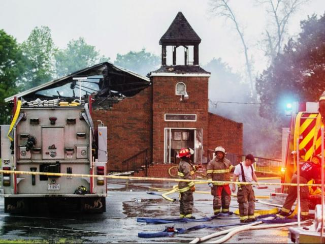 Firefighters and fire investigators respond to a fire at Mt. Pleasant Baptist Church Thursday, April 4, 2019, in Opelousas, La. (Leslie Westbrook/The Advocate via AP)