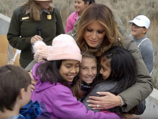 First Lady Melania Trump joins in a group hug with children at the Grand Teton National Park. (Screenshot credit: White House/Youtube)