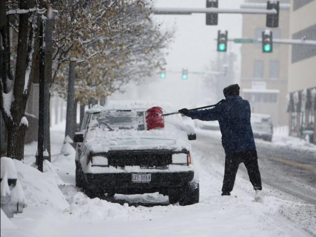 John Woodrum, shovels his car on Sunday, Dec. 9, 2018, in Roanoke, Va. AP photo.