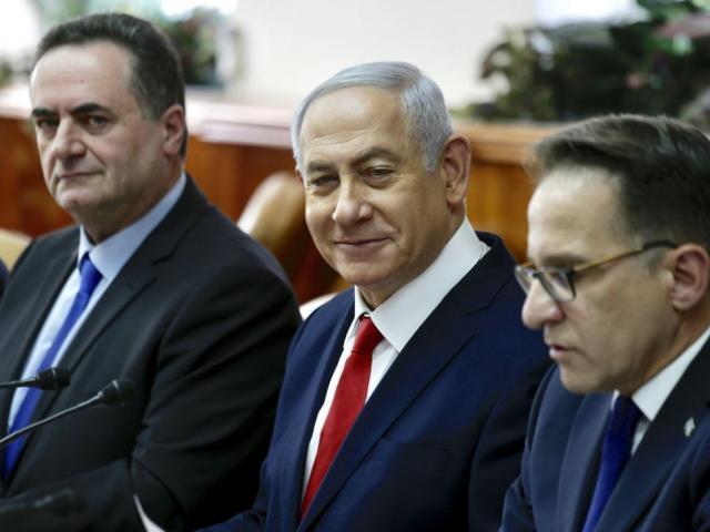 Israeli Prime Minister Benjamin Netanyahu, sits between Minister of Transport Israel Katz, left, and Government Secretary Tzahi Braverman during his weekly cabinet meeting in Jerusalem, Sunday, Jan. 13, 2019. AP Photo.