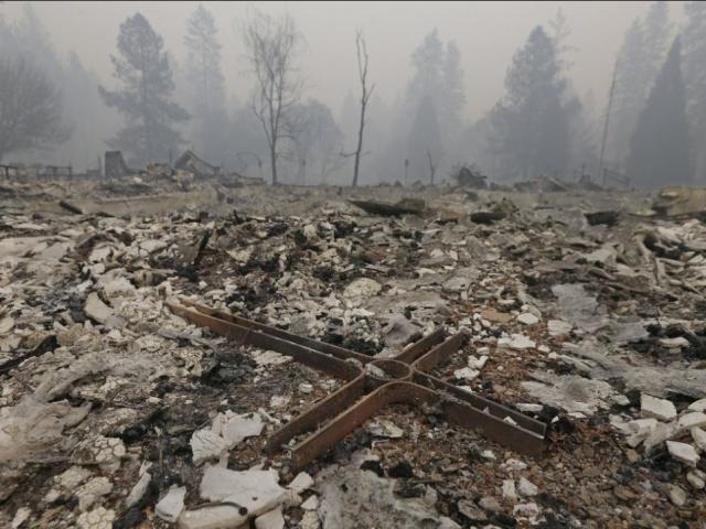 A cross is among the rubble of the Our Savior Lutheran Church Friday, Nov. 9, 2018, in Paradise, Calif. The church was destroyed by a wildfire that swept through the area. (AP Photo)
