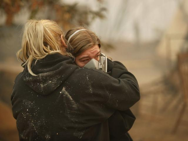 Krystin Harvey, left, comforts her daughter Araya Cipollini at the remains of their home burned in the Camp Fire, Saturday, Nov. 10, 2018, in Paradise, Calif. AP Photo.
