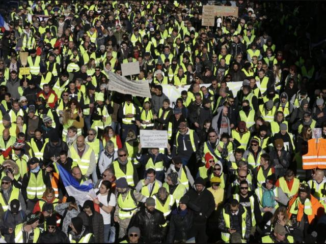 Demonstrators wearing yellow vests march Saturday, Dec. 8, 2018 in Marseille, southern France. AP photo.