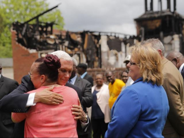Vice President Mike Pence hugs a church member as he visits with three congregations at the Mt. Pleasant Baptist Church, which was burned along with two other nearby African American churches, in Opelousas, La., Friday, May 3, 2019. (AP Photo)