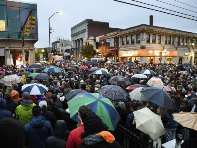 People gather for a vigil on Murray and Forbes Avenues, blocks from where an active shooter shot multiple people at Tree of Life Congregation synagogue on Saturday, Oct. 27, 2018, in the Squirrel Hill section of Pittsburgh.