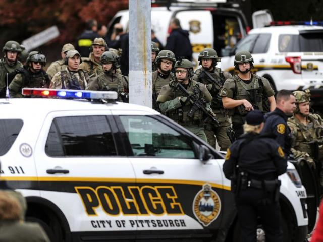 Law enforcement officers secure the scene where multiple people were shot, Saturday, Oct. 27, 2018, at the Tree of Life Congregation in Pittsburgh's Squirrel Hill neighborhood. AP Photo.