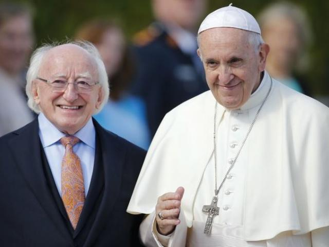 Pope Francis, right, is flanked by Irish President Michael D. Higgins, upon his arrival at the Presidential residence in Dublin, Ireland, on Saturday.