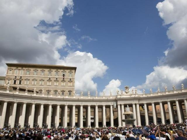 Faithful and pilgrims gather in St. Peter's Square to hear Pope Francis. AP Photo.
