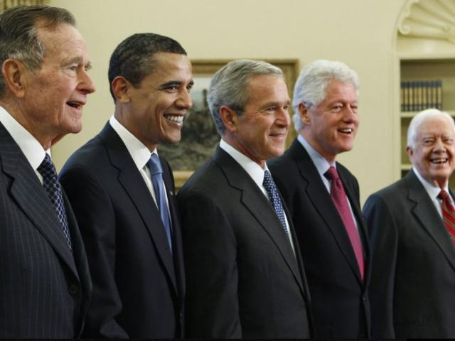 In this Jan. 7, 2009, file photo, President George W. Bush, center, poses with President-elect Barack Obama, second left, and former presidents, George H.W. Bush, left, Bill Clinton, second right, and Jimmy Carter, right. AP photo.