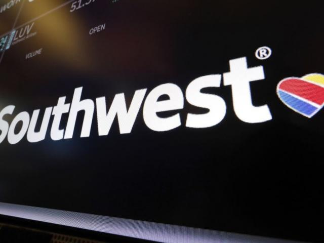 In this Monday, March 18, 2019, file photo, the logo for Southwest Airlines appears above a trading post on the floor of the New York Stock Exchange. (AP Photo/Richard Drew, File)