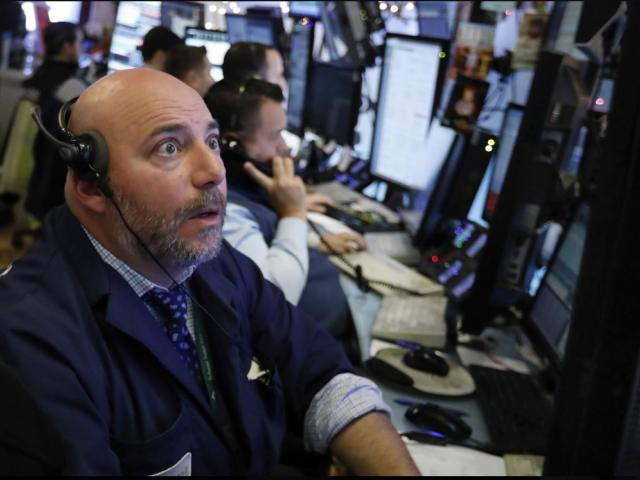 Trader Vincent Napolitano works on the floor of the New York Stock Exchange, Monday, Dec. 3, 2018. AP photo.