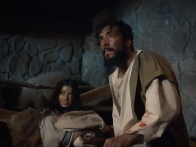 """Mary holding the baby Jesus, and Joseph in a scene from the pilot episode of """"The Chosen."""" Screenshot courtesy: The Chosen Productions/YouTube"""