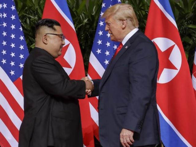 US President Donald Trump and North Korean leader Kim Jong Un meet during their first summit on June 12, 2018. (AP Photo.