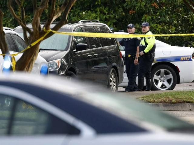 Law enforcement officials work outside a municipal building that was the scene of a shooting, Saturday, June 1, 2019, in Virginia Beach, Va.  (AP Photo/Patrick Semansky)