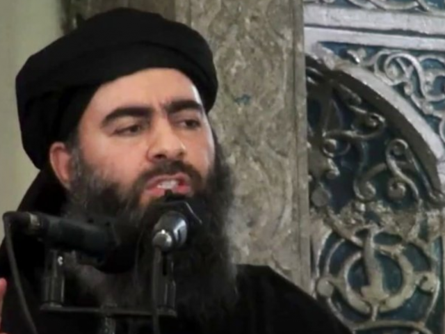 Abu Bakr al-Baghdadi delivering a sermon at a mosque in Iraq during his first public appearance (AP Photo/Militant video, File)