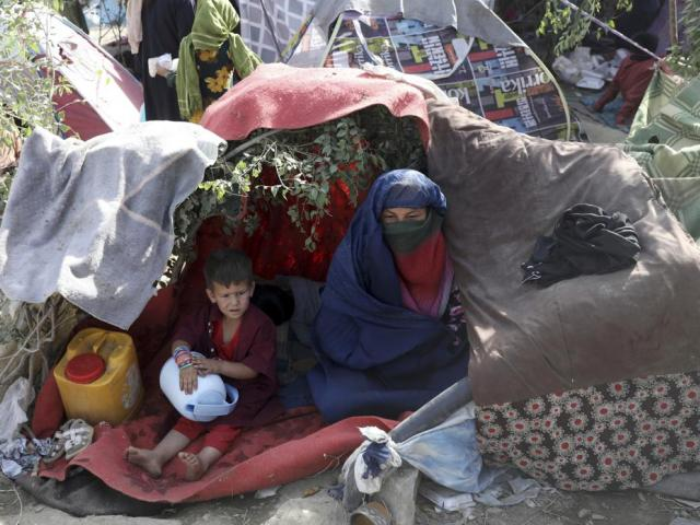 Displaced Afghans from northern provinces take refuge in a public park Kabul, Afghanistan, Friday, Aug. 13, 2021. (AP Photo/Rahmat Gul)