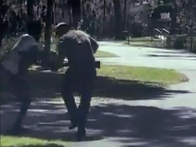 This image from video posted on Twitter May 5, 2020, purports to show Ahmaud Arbery, struggling with Travis McMichael over a shotgun in a neighborhood outside Brunswick, Ga., on Feb. 23, 2020. The AP has not been able to verify the source of the video.