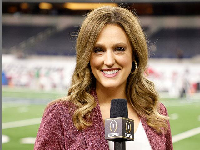 Allison Williams, sideline reporter with ESPN poses for a photo on the field at AT&T Stadium before the Rose Bowl NCAA college football game between Notre Dame and Alabama in Arlington, Texas, Friday, Jan. 1, 2021. (AP Photo/Michael Ainsworth)