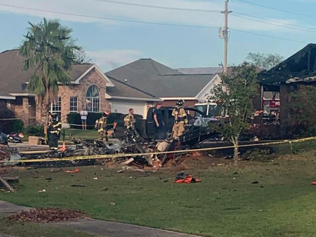 U.S. Navy training plane crashed in residential neighborhood near the Gulf Coast, Friday, Oct. 23, 2020 near Foley, Ala.(Greg Crippen via AP)