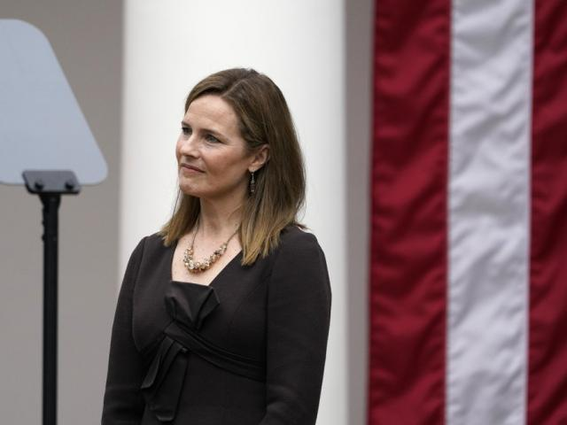 Judge Amy Coney Barrett listens as President Trump announces Barrett as his nominee to the Supreme Court (AP Photo/Alex Brandon)