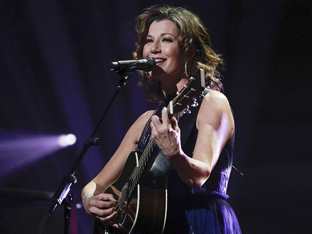 In this Oct. 15, 2019 file photo, singer Amy Grant performs during the Dove Awards in Nashville, Tenn (AP Photo/Mark Humphrey, File)