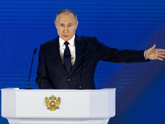 Russian President Vladimir Putin gestures as he gives his annual state of the nation address in Manezh, Moscow, Russia, Wednesday, April 21, 2021. (AP Photo/Alexander Zemlianichenko)