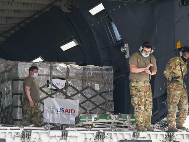Relief supplies from the United States in the wake of India's COVID-19 situation arrive at the Indira Gandhi International Airport cargo terminal in New Delhi, India, Friday, April 30, 2021. (Prakash Singh/Pool via AP)