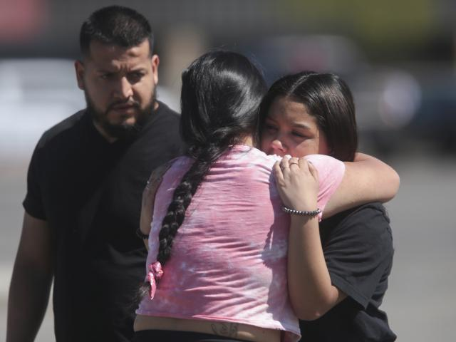 People embrace after a school shooting at Rigby Middle School in Rigby, Idaho on Thursday, May 6, 2021. (John Roark /The Idaho Post-Register via AP)