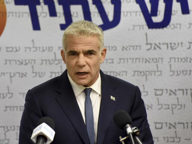 Chairman of the Yesh Atid Party, Yair Lapid, delivers a statement to the press in the Knesset, the Israeli Parliament, in Jerusalem, on Monday, May 31, 2021. (Debbie Hill/Pool via AP)