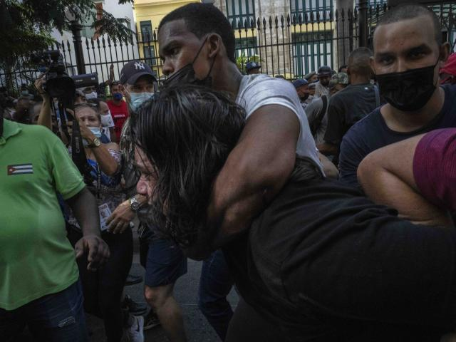 Plainclothes police detain an anti-government protester during a protest in Havana, Cuba, Sunday, July 11, 2021.(AP Photo/Ramon Espinosa)