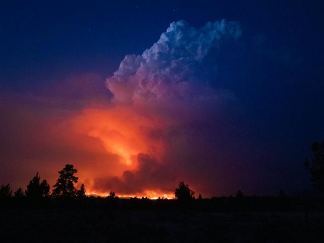 In this photo provided by the Oregon Office of State Fire Marshall, flames and smoke rise from the Bootleg fire in southern Oregon on Wednesday, July 14, 2021. (John Hendricks/Oregon Office of State Fire Marshal via AP)