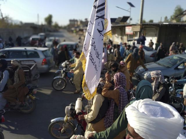 Taliban fighters are seen inside the city of Farah, capital of Farah province southwest of Kabul, Afghanistan, Tuesday, Aug. 10, 2021. (AP Photo/Mohammad Asif Khan)