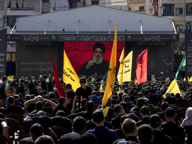 Hezbollah supporters listen to their leader Sayyed Hassan Nasrallah as he speaks via a video link in southern Beirut, Lebanon, Thursday, Aug. 19, 2021. (AP Photo/ Hassan Ammar)