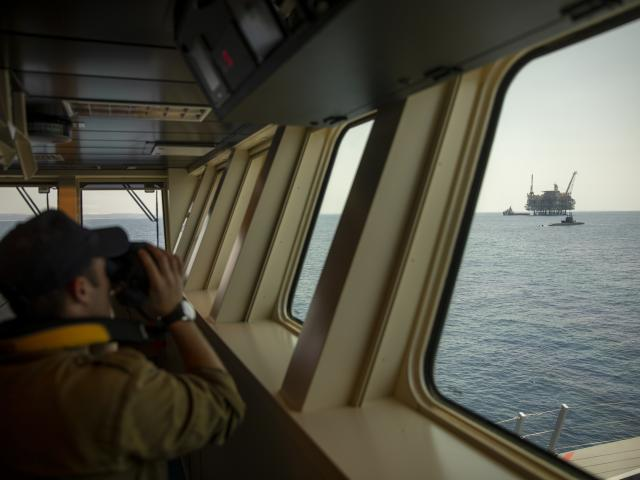 An Israeli Navy sailor looks at Israel's offshore Leviathan gas field from on board the Israeli Navy Ship Atzmaut as a submarine patrols in the Mediterranean Sea , Wednesday, Sept. 1, 2021.