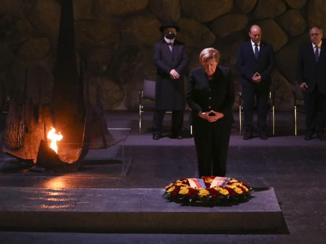 German Chancellor Angela Merkel, pauses after laying a wreath at the Hall of Remembrance. (AP Photo/Ariel Schalit)