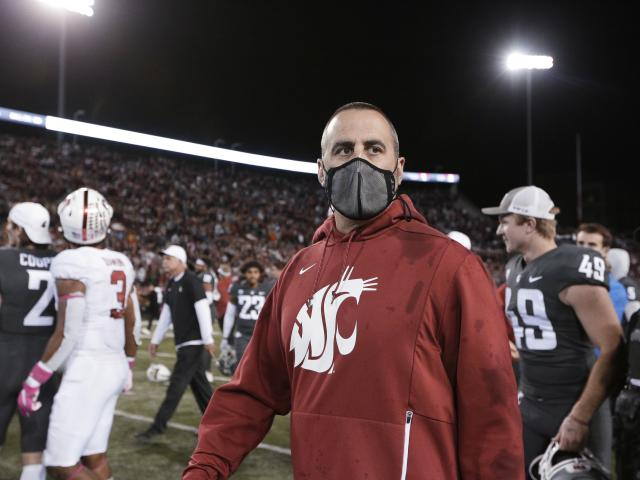 Washington State coach Nick Rolovich walks on the field after the team's NCAA college football game against Stanford, Saturday, Oct. 16, 2021, in Pullman, Wash. Washington State won 34-31. (AP Photo/Young Kwak)
