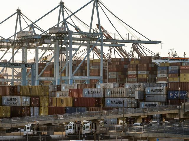 In this Tuesday, Oct. 19, 2021, photo shipping containers are stacked up at Maersk APM Terminals Pacific at the Port of Los Angeles. (AP Photo/Damian Dovarganes)
