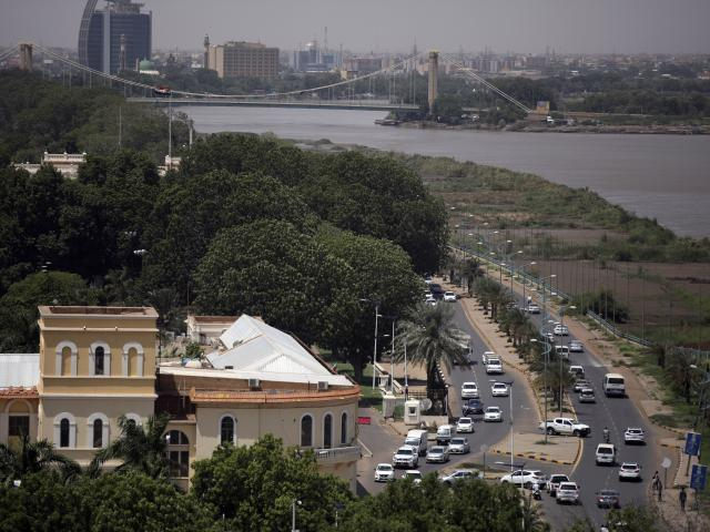 In this Sept. 21, 2021, file photo, traffic moves on a street in Sudan's capital Khartoum. (AP Photo/Marwan Ali, File)