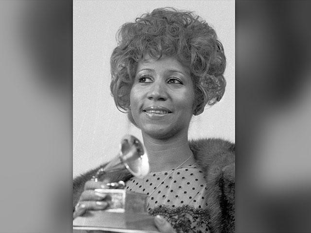 "More than 46 years after it was shot, the Aretha Franklin concert film ""Amazing Grace"" will finally be released.  AP File Photo: Franklin holds her 1972 Grammy Award for best est Rhythm and Blue performance of the song ""Bridge Over Troubled Waters."""