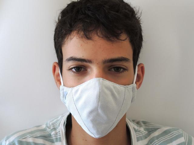 A man wearing a prototype of Argaman Technologies' antiviral face masks developed in Jerusalem