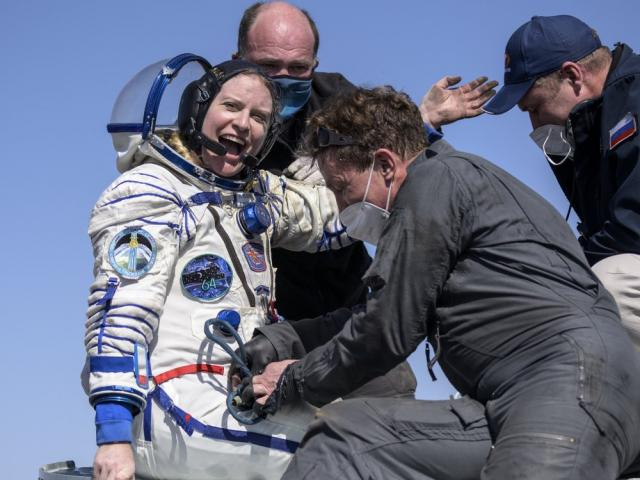 Expedition 64 NASA astronaut Kate Rubins is helped out of the Soyuz MS-17 spacecraft (Bill Ingalls/NASA via AP)