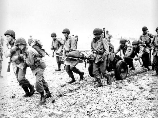 In this June 23, 1943 file photo, U.S. Army reinforcements land on a beach during World War II on Attu Island, part of the Aleutian Islands of Alaska.