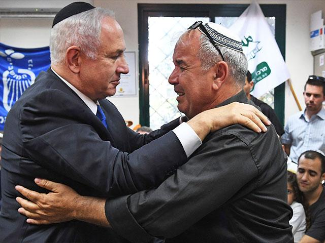 Prime Minister Netanyahu Consoles David Malka, the Father of Staff Sgt. Hadas Malka, Killed in Friday's Terror Attack, Photo Courtesy GPO
