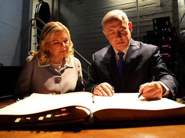 Israeli Prime Minister Benjamin Netanyahu and his Wife, Sara, Sign the Visitor's Book at AMIA, Photo, AP/GPO